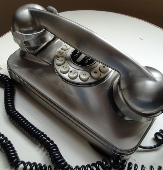 Vintage Wall Phone in stainless steel and black finish a really cool look to go in your stainless kitchen plug in and it WORKS reproduction