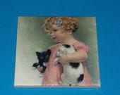 Adorable Little Girl Holding Puppy and Kitten Ceramic Tile