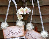 Bride and groom wedding signs