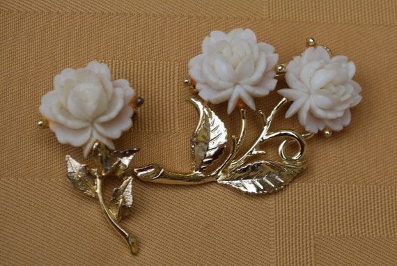 two white cabochon flower brooches