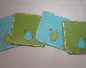 Colorful green and turquoise coasters with whimsical birds