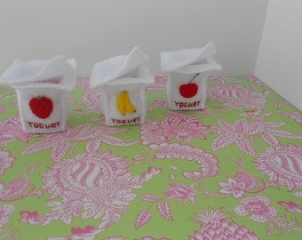 Set of three felt yogurts three different flavors banana cherry strawberry