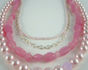 Long, layered pink statement necklace by Cerise Jewelry. Sterling silver, glass, pearls.