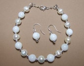 White lampwork glass with potato pearls Bracelet / Earring set. Silver plated ear wires.