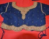 Blue lengha choli had heavy beadwork and gold bullion borders