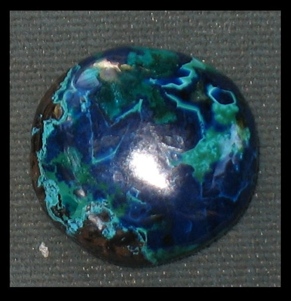 Shattuckite, dioptase, cuprite chrysocolla freeform cabochon 18.5round x 6.3mm thick at 4.8grams