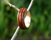 Bubinga Bentwood ring with Birch liner, decorative channels, size 7