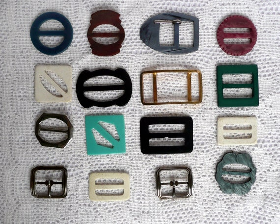 Sixteen vintage buckles, a collection of vintage metal and plastic buckles of various size and colour