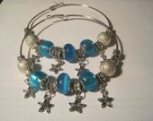 Basketball Wives Style Hoop Earrings w/Blue Beads & Star Charms