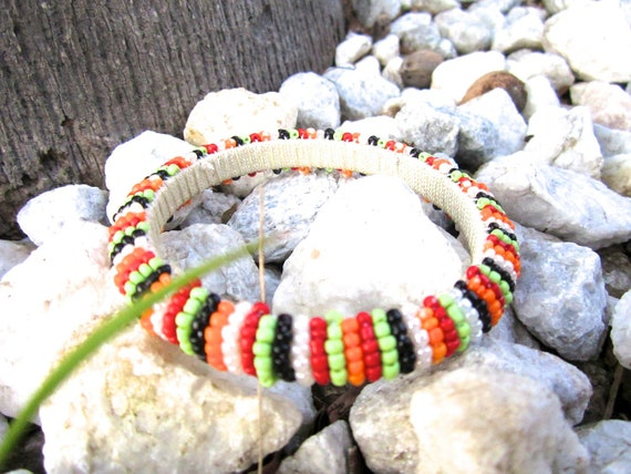 Handmade bracelet in red, green and orange beads, round bangles, colorful bead bangles