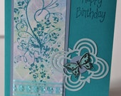 Birthday Card, teal floral with pastel chalked grid, ribbon and butterfly