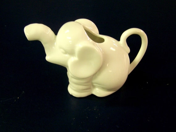 Vintage small ceramic white elephant creamer