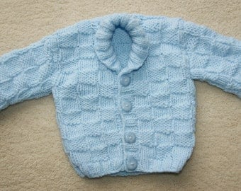 Hand knitted baby aran cardigan in pastel blue