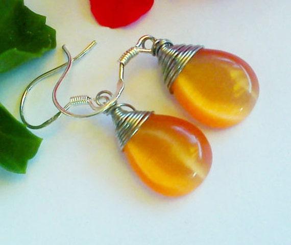 Orange wire wrapped earrings..handmade by i.p.