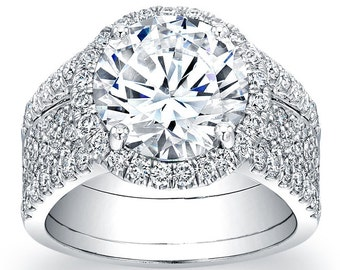 Women's 18kt white gold French pave engagement ring with a natural 3ct (9mm) Round White Sapphire center and 1.33 ctw diamonds