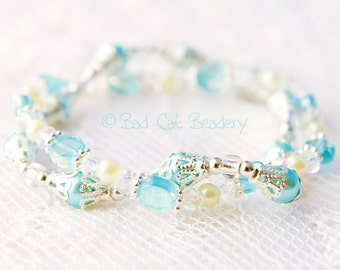 Silver Blue Stretch Bead Stack Bracelets in Shimmery Iridescent Blue, Light Yellow, Silver