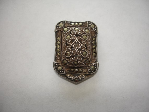Vintage Marcasite Dress Clip marked Sterling One stone missing.