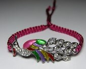 Peacock bracelet with rhinestones  in silver metal and enamel, raspberry nylon cord