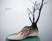 Branches and roots in wooden shoe last-recycled materials