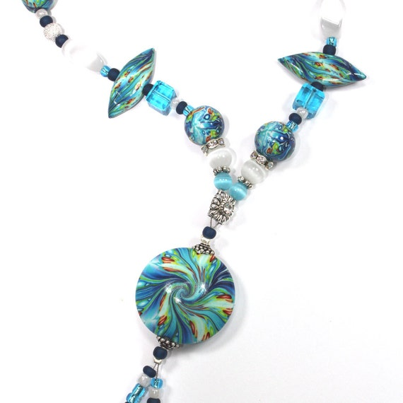 Polymer clay necklace, elegant necklace, blue, turquoise, green, red and yellow, Swarovski stones and cat eye beads.