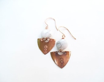 30% off... Regular 12.00 on sale for 8.40.. Copper shield drop earrings with white marbled bead