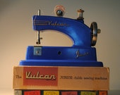 RESERVED .blue Vulcan childrens sewing machine antique made in England lovely blue with grips vulcan Junior with box