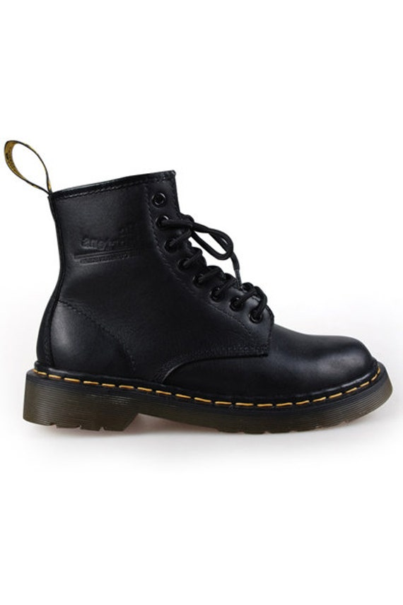 With 8 eyelets (shoelace rings) embellishing each side, genuine leather in solid black or brown (to start), and a border of thick yellow stitches securing the upper to the outsoles, the original Dr. Martens were - and still are - unmistakable.