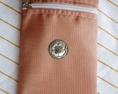 Zipper cell phone bag with long strap.