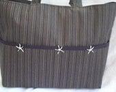 Large brown & black striped bag with large pockets.