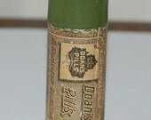 DOANS PILLS CONTAINER - Vintage cylinder shaped tin c.1940 - 1950 - Beautiful shade of green with original label