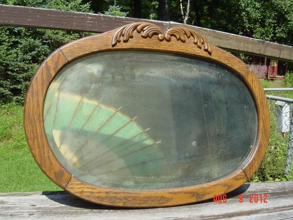 Simple 1920's Oak Framed Beveled Oval Mirror