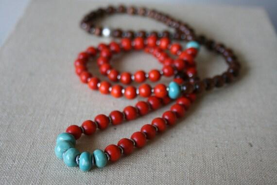 Fair Trade 108-bead orange brown wood and turquoise kazuri beads