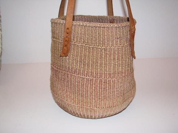 Market Bag. Sisal bucket bag.  Natural leather handles.  Good vintage condition. Circa 1970's - early 1980's.