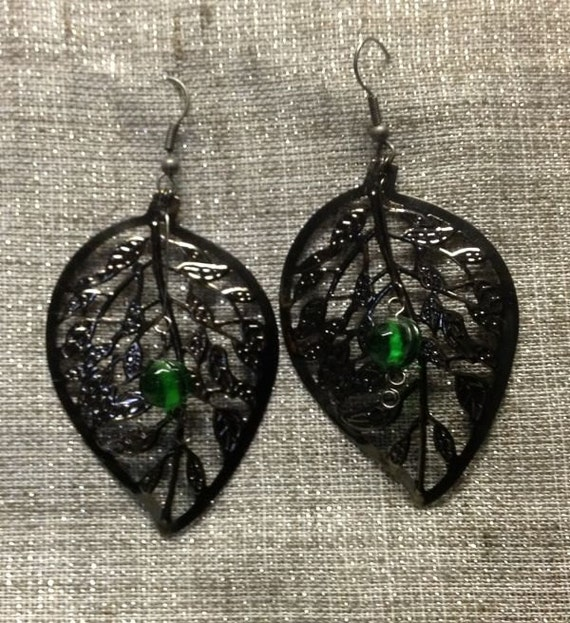 Dark Dangle leaf earrings with emerald green glass color pop by notsoseemless