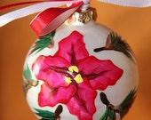 Hand painted glass Christmas tree holiday ornament, red pointsettia, red and white ribbon, green pine branches