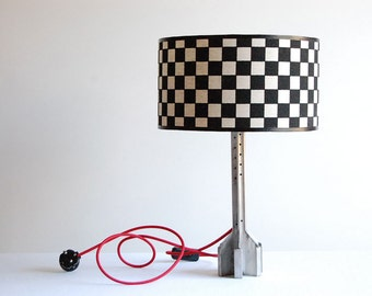Start your engines. Handcrafted, checkered flag, desk lamp