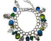 Owl charm bracelet, blue & green, silver.