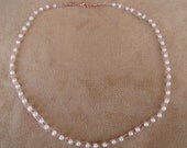 Seed pearls on knit rose gold wire. 21 inches in length.