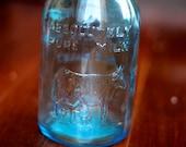 1965 Blue Glass Milk Bottle