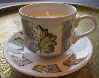 Retro Mid-century cup and saucer scented soy candle, decorated with autumnleaves