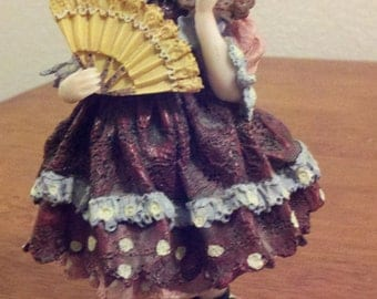 Beautiful Figurine of a Girl Holding a Fan