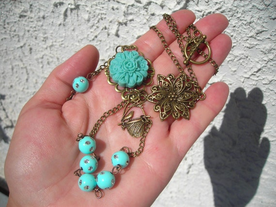 My blue turquoise BIRD & FLOWER extra long necklace with turquoise crystal dot beads