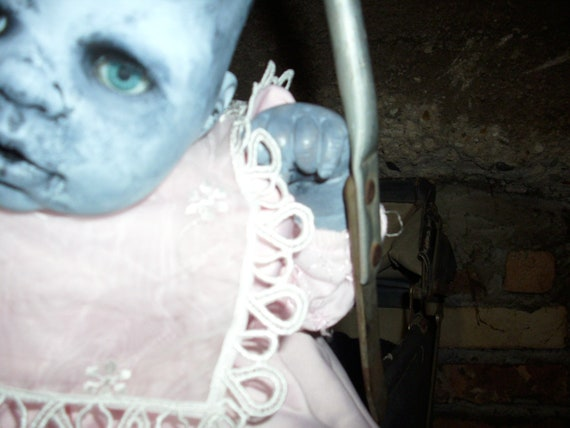 Frightening ghost girl doll Evangeline