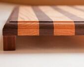 Handcrafted  Walnut & Hard Maple cutting board with wooden feet 16x10