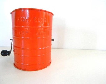 vintage red/orange bromwell flour sifter