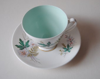 Vintage China teacup, saucer and tea plate.   Queen Anne Louise bone china with white and green leaf design