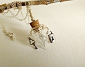 Angel wing under lock and key charm glass vial necklace