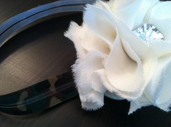 Cream flower with large rhinestone center on a camouflage headband