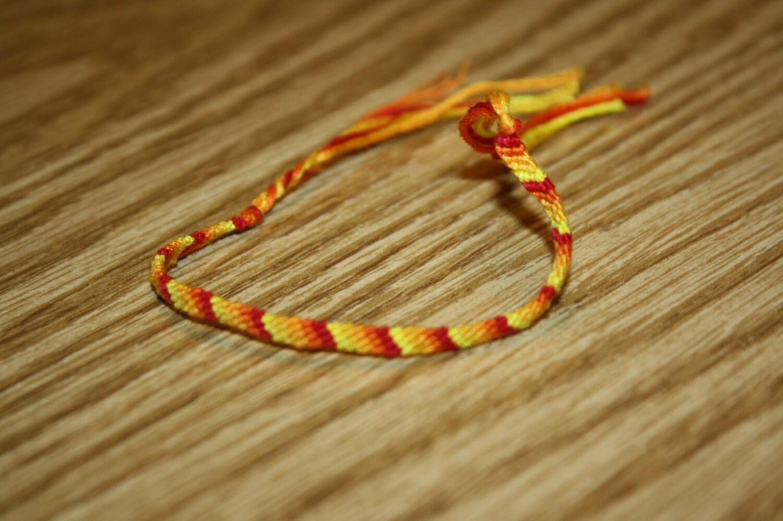 Handmade 5-string friendship knit bracelet.