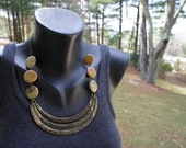 Antiqued gold statement necklace with jasper coin beads